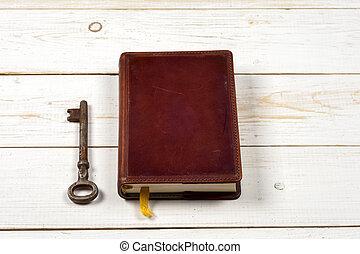 old keys on book, antique wood background
