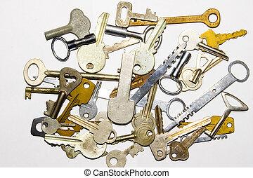 old keys - the many old keys on white background