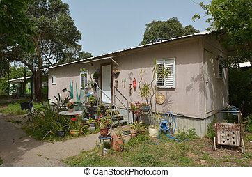 Old kibbutz house - MAAGAN MICHAEL, ISR - APR 2015:An old...