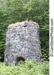 Old kiln - Overgrown 19th-century stone kiln sits...