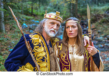 Old king and queen in the forest