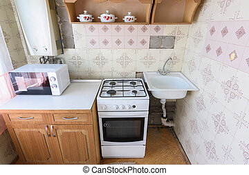 Old kitchen set in the interior of the kitchen in need of ...
