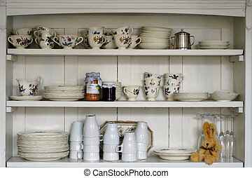 Old kitchen shelf - The photograph of an old kitchen shelf...
