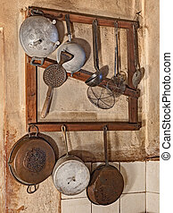 old kitchenware - kitchenware hanging in the kitchen of an ...