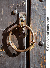 Old knocker on the wooden door