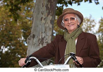 Old lady on a bike ride