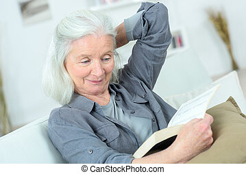 old lady reading on the sofa