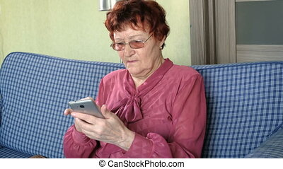 Old lady talking on the phone and holding credit card Cute...