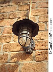 Old lamp brown brick wall.