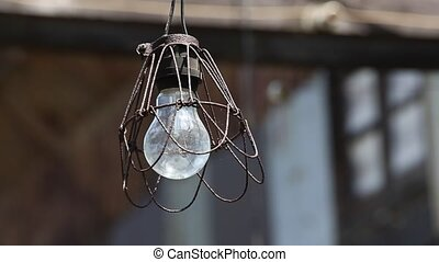old lamp bulb - old light bulb in abandoned barn on the wind...