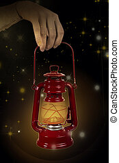 Old lamp in hand