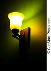 Old lamp on a green wall