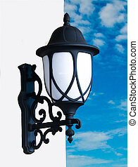 Old lamp on blue sky background