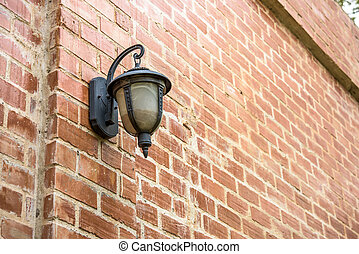 Old lamp on brick wall