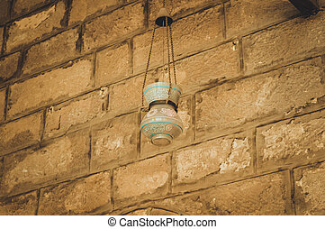 old lamp on wall at old mosque at cairo, egypt