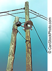 Old lamp on wooden post with security cameras