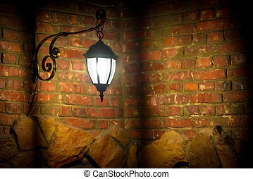 Old lamp on the red brick wall