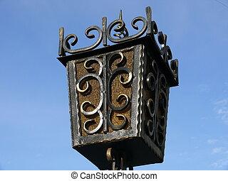 Old lantern in blue sky background