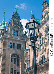 Old lantern in front od Hamburg City Hall Towers. Germany