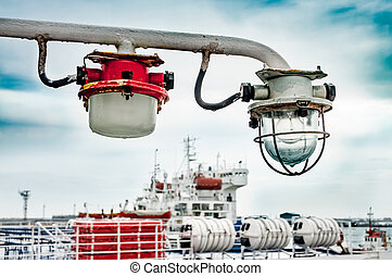 Old lantern light on a ship isolated against the sky and the...