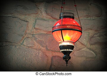Old lantern on a stone wall