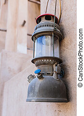 Old lantern on the wall.