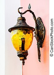 Old lantern on the wall