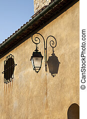 Old Lantern - Stucco building and old lantern in sunlight...