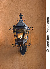 Old lantern - Old black lantern on adobe wall