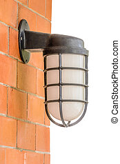 Old lantern on the orange brick wall