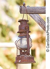 old lantern hands on a pole