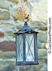Old lantern hanging on rope