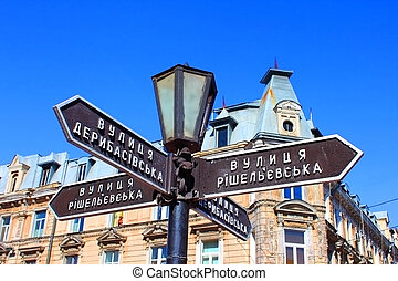 Old lantern with street signs to famous Deribasovskaya street in downtown Odessa, Ukraine