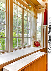 Old large window with heating water radiator. - Large window...