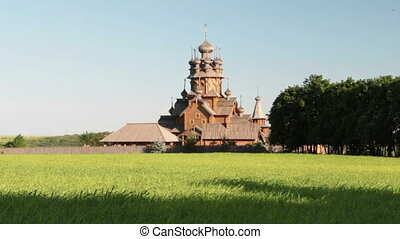 Old large wooden orthodox church. Summer sunny day.