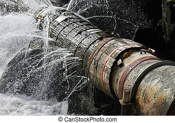A broken pipe that leaks water in all directions.