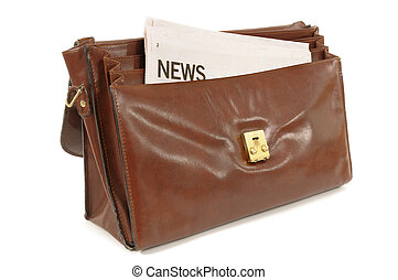 Old leather briefcase with newspaper