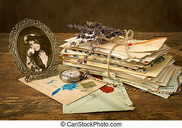 Old letters and a portrait - Antique portrait of a woman and...