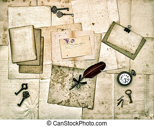 old letters and photos, vintage keys, antique clock, feather ink