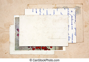 old letters, empty post cards and two hearts