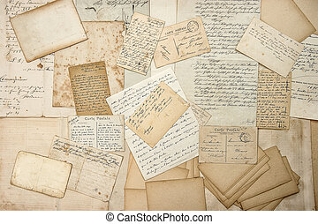 old letters, handwritings, vintage postcards, ephemera. grungy nostalgic sentimental paper background