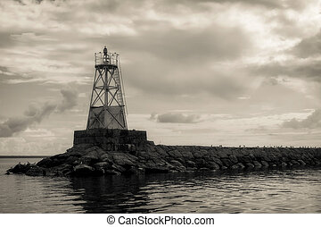 Old lighthouse in Ladoga lake, Russia. Retro photo effect.