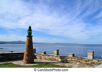 Old lighthouse in seaport of Tapia