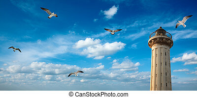 Old lighthouse in the sky with seagulls
