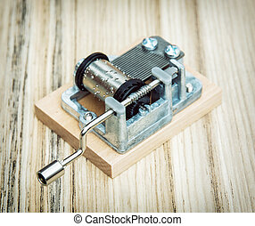 Old little music box on the wooden background, retro style