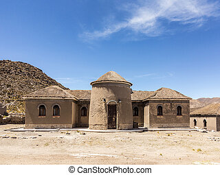 old loam house in the desert at Alcaya in Bolivia