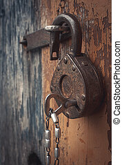 Old lock - Old open padlock with key on a chain. Photo...
