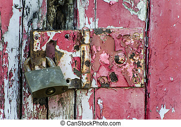 old lock on a weathered door