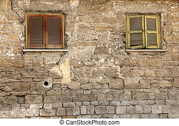 Old locked windows in vintage wall