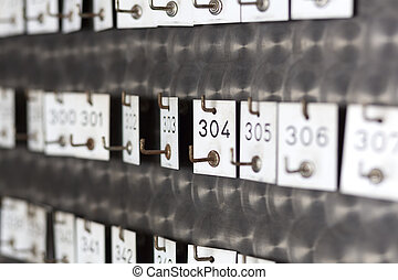Old locker tags with engraved numbers, shot with shallow DOF